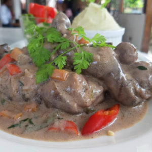Slow Cooked Goat with grits